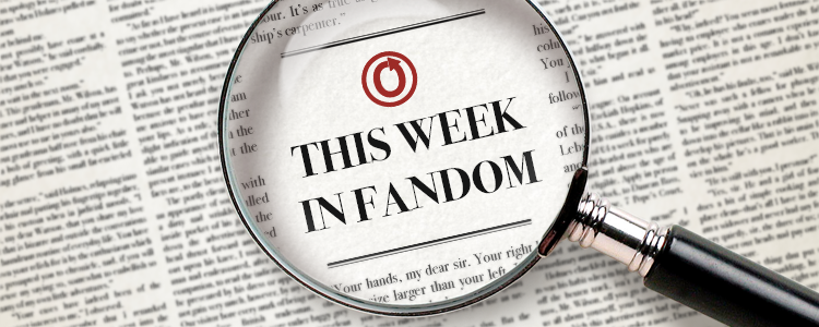 Image of a newspaper. The print is mostly tiny and blurred out but a magnifying glass in the center of the image highlights text reading 'This Week in Fandom'.